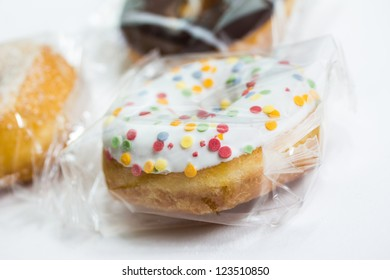 a mix of packaged donuts