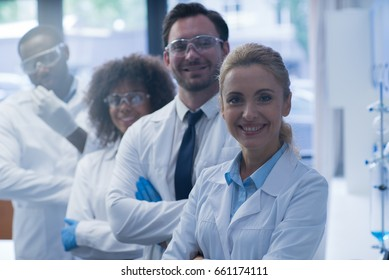 Mix Race Scientists Team Happy Smiling Working In Laboratory Doing Research, Man And Woman Making Scientific Experiments Doctors In Lab