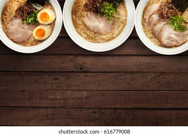 mix ramen japanese noodles with soup  top view on dark wood background