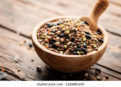 Mix of raw legumes on the rustic table, selective focus