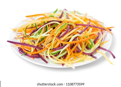 mix red, yellow, orange carrots, zucchini and cucumber julienned vegetables for salad on plate, concept of healthy food