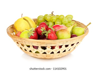 Mix of ripe sweet fruits and berries in basket isolated on white