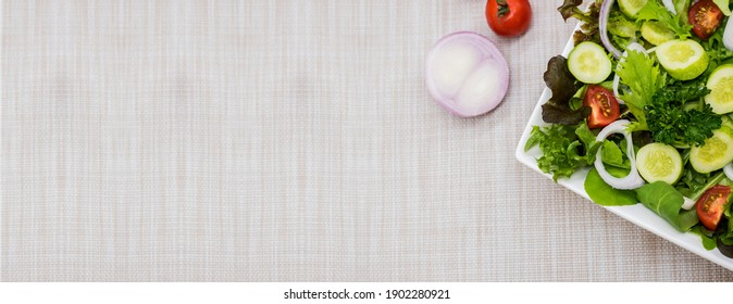 Mix Salad and healthy food. Fresh organic vegetables for cooking diet food on table background.