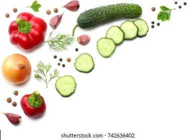 mix of sliced cucumber, garlic, sweet bell pepper and parsley isolated on white background. top view