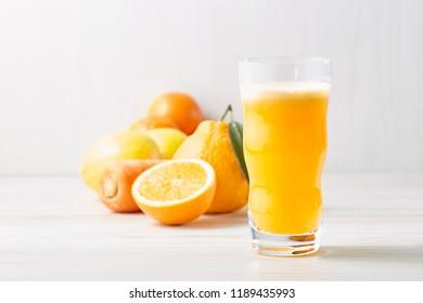 Mix smoothie on white backboard blackground (orange, lemon , satsuma mandarin )