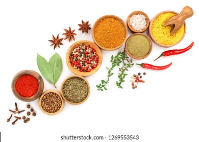 mix of spices in wooden bowl isolated on a white background with copy space for your text. Top view. Flat lay. Set or collection