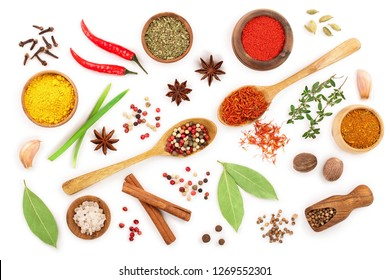 mix of spices in wooden spoon isolated on a white background. Top view. Flat lay. Set or collection