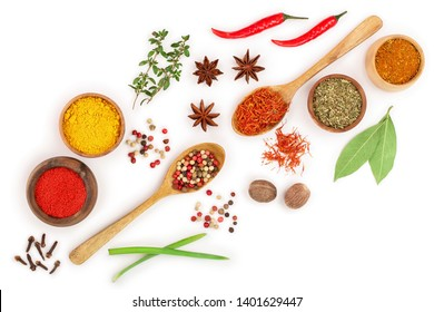 mix of spices in wooden spoon isolated on a white background with copy space for your text. Top view. Flat lay. Set or collection