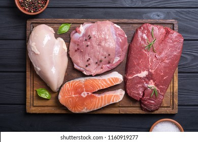 Mix of steak meat : salmon , beef , pork and chicken
