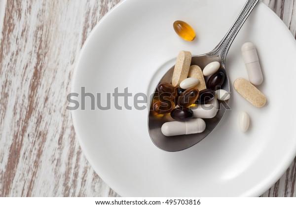 mix supplement antioxidant still life glutathione astaxanthin biotin saw palmetto vitamin c