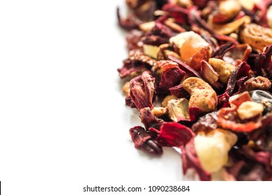 Mix tea with dried fruits, dried flowers and berries close-up, texture, background