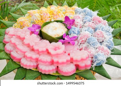 Mix of Thai Dessert including Soft mung-bean crepe, Steam Layer Sweet Cake (Kanom Chan) and Coconut Ball or Kanom Ko.  Traditional Thai Dessert