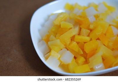 Mix tropical fruit for making dessert.