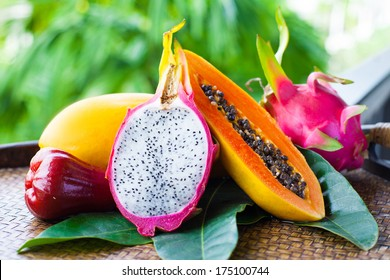mix tropical fruits with leaves