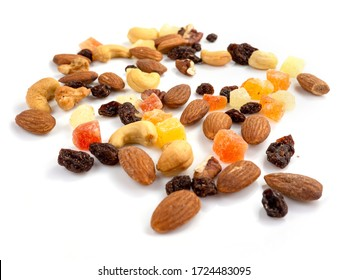 Mix of various nuts and dried fruit on white, Almonds, Raisins, Nuts, top view