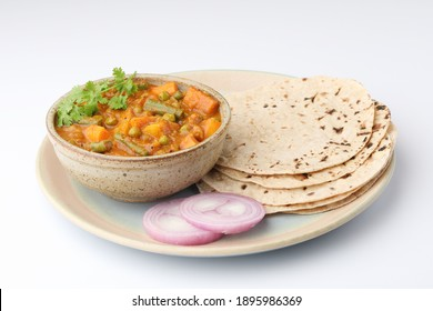 mix veg curry made from beans, carrot, potato coriander topping with chapati and onions, Indian food plate or thali