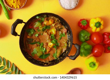 MIX VEGETABLE CURRY- indian recipe, mixed veg containing Carrots, cauliflower, green peas and beans with traditional masala and curry, red hot and spicy served in a ceramic bowl