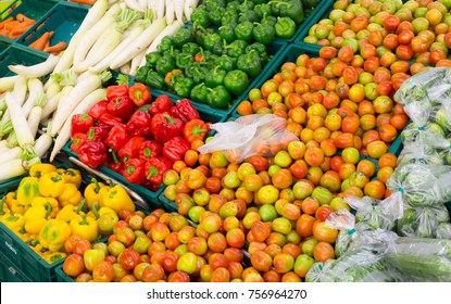 Mix vegetable showcase basket in the grocery store or market place.