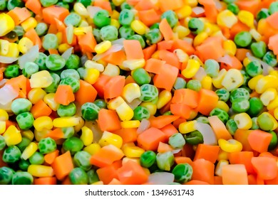 Mix of vegetables with corn, peas and cubic of carrot background