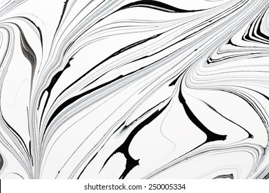 Mix of a white and black paint, closeup. Backgrounds.