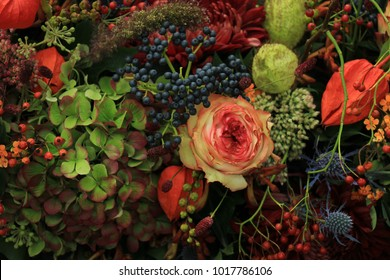Mixed autumn flower arrangement: various flowers in different autumn colors for a fall wedding