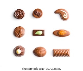 Mixed belgian pralines. Chocolate truffles isolated on white background.