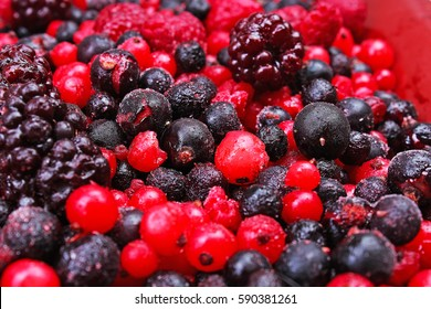 Mixed berries as background. Blueberries,raspberries black berries and currant mulberry texture pattern. Frozen red and black berries.