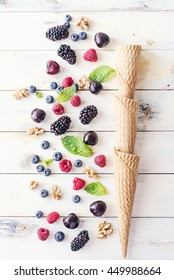 Mixed berries and ice cream cones