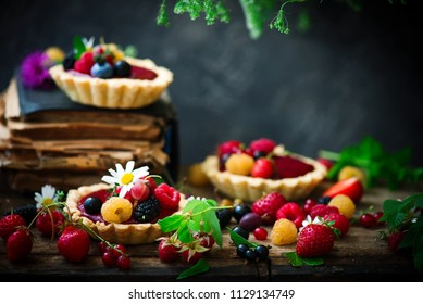 MIXED BERRY CURD TARTELETTES.rustic style.selective focus