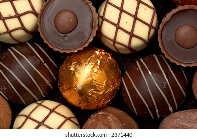 Mixed Chocolates, milk and dark, against a black background