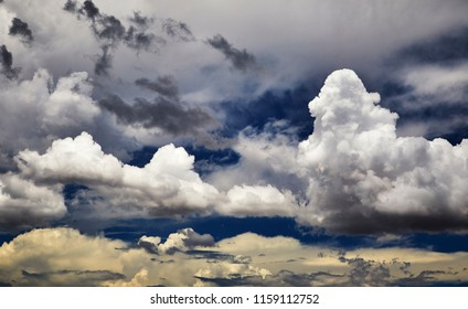 Mixed cloud formations against a blue sky
