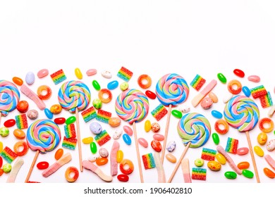 Mixed collection of colorful candy, on white background. Flat lay, top view