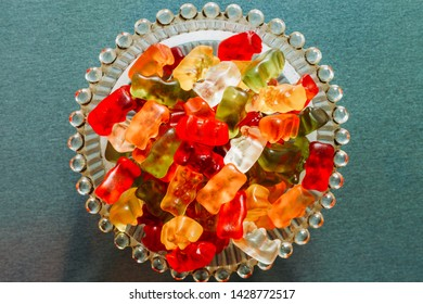Mixed color gummy bears placed in a glass blow – Sweet and tasty treats with fruit flavor – Soft textured sugary candies
