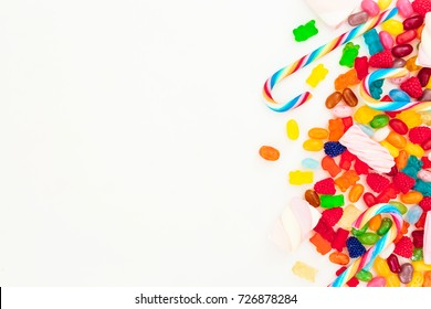 Mixed colorful candies isolated on white background. Flat lay, top view