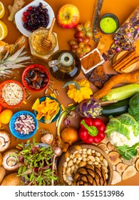 Mixed colorful foods, and pills, contains antioxidants, vitamins, fiber. Immune boosting products. Healthy clean concept. Superfoods