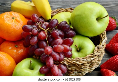 Mixed colorful fresh fruits in basket