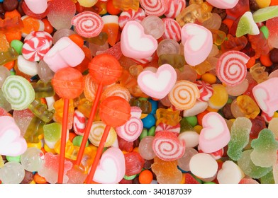 Mixed colorful fruit candies and jellies as background