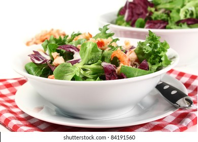 mixed, colorful salad with crayfish on a white background