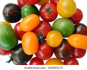 mixed colorful variation of fresh cherry or cocktail tomatoes isolated on white background