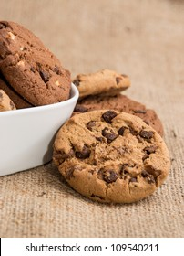 Mixed Cookies in a bowl on brown background