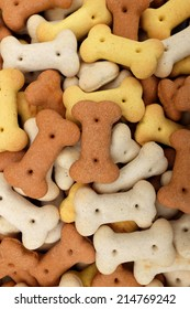 Mixed dog biscuits as a vertical abstract background texture