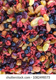 Mixed dried fruit including cranberries raisins currents blueberries goji berries and almonds for snacking on while trecking