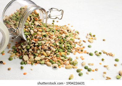 Mixed dried legumes and cereals isolated on white background. Top view.