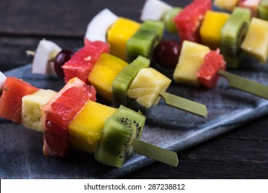 Mixed exotic fruits on skewers, party healthy snack