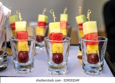 Mixed exotic fruits on skewers, party snack on slate platter