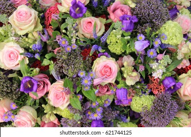Pink and purple flowers images stock photos vectors shutterstock mixed flower arrangement wedding flowers in pink and purple blue mightylinksfo