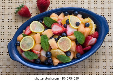 Mixed fresh fruit cut, sliced, cubed. A colorful variety in a blue oval bow. Healthy, raw, and fresh - a satisfying choice for a healthy lifestyle. Just picked, farm to table, Farmers market finds