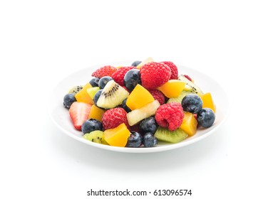 mixed fresh fruits (strawberry, raspberry, blueberry, kiwi, mango) on white background