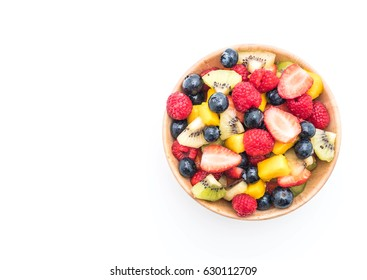 mixed fresh fruits (strawberry, raspberry, blueberry, kiwi, mango) on white background
