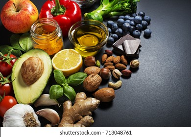 Mixed of fresh healthy food on dark background